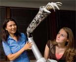 Yoky Matsuoka with the robotic arm